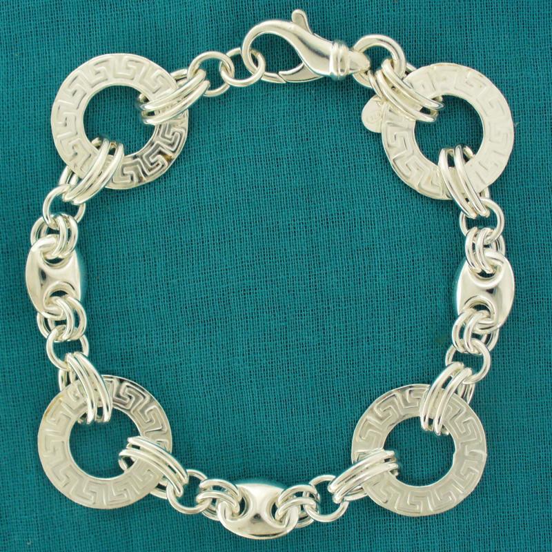 Sterling silver bracelet with Greek textured link.