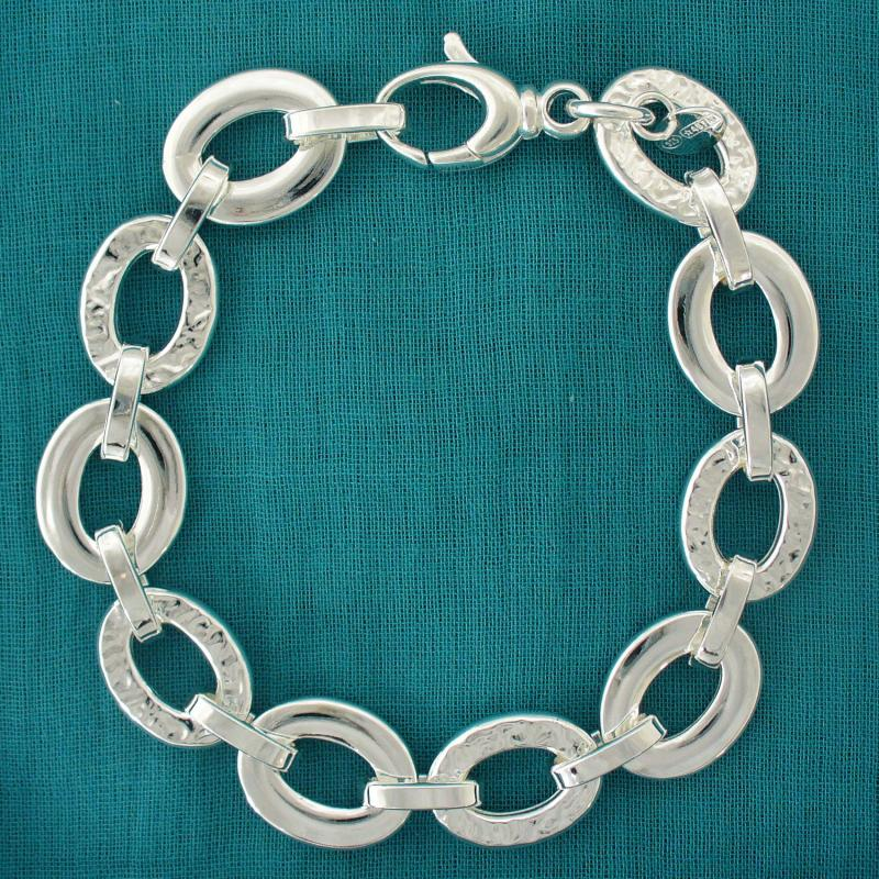 Sterling silver bracelet textured and polished oval link