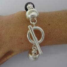 Sterling silver bracelet with black onyx & natural madrepore.