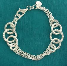 Solid silver textured round link bracelet with chains.