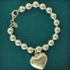 Sterling silver bead bracelet 10mm with heart charm.
