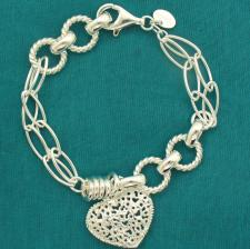 Solid 925 silver bracelet with textured heart.