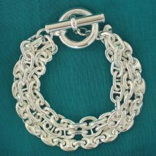 Sterling silver triple chain bracelet. Hollow chain. T-bar closure.