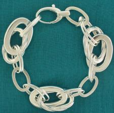 Sterling silver flat-textured oval link bracelet 20mm. Hollow chain.