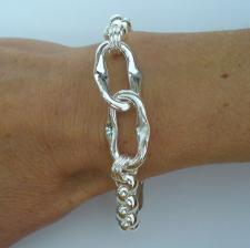 Bracciale artigianale argento 925 maglia allungata asimmetrica e maglie tonde. Larghezza 17mm.