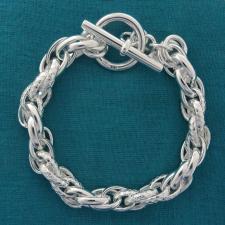 Bracciale in argento 925 massiccio, larghezza 8,5mm. Maglie ovali doppie lisce e godronate. Chius...