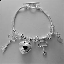 Sterling silver snake charm bracelet. Heart and keys. T-bar closure.
