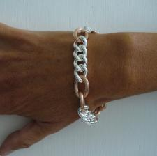 Sterling silver with 18 kt rose gold plating.