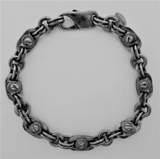 Silver bracelet with screws.
