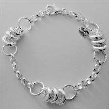 Bracciale in argento 925, rolo tondo e ''ciambelline''.