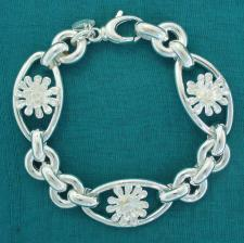 Sterling silver flower bracelet. Three flowers.