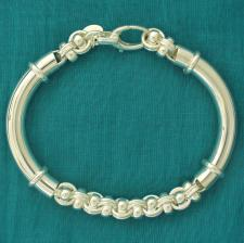 Sterling silver semi-bangle bracelet with handcrafted solid link chain.