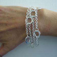 Sterling silver triple chain bracelet with round flat link. Solid chain.