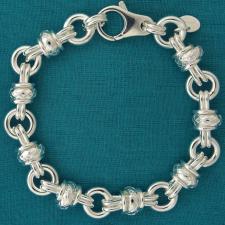 Handmade solid sterling silver bracelet 10.5mm. Textured round link bracelet.
