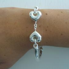 Sterling silver bangle bracelet with hearts.