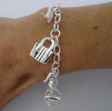 Silver bag and shoe charm bracelet.