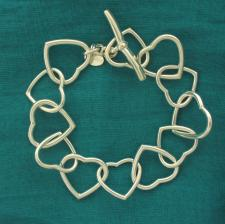 Solid sterling silver heart link bracelet 20mm. T-bar closure.