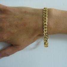 Sterling silver diamond cut curb bracelet with 18 kt gold plating.