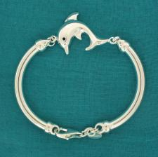 Sterling silver bangle bracelet with dolphin.