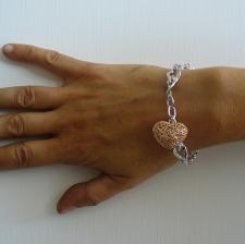 Sterling silver heart bracelet with rose gold plating charm