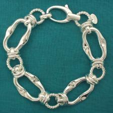 Bracciale artigianale argento 925 maglia allungata asimmetrica e maglie tonde godronate. Larghezz...