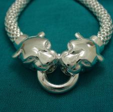 Sterling silver Pop Corn bracelet with double panther heads.