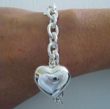 Sterling silver heart charm bracelet.