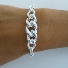 Sterling silver semi-bangle bracelet with curb link.