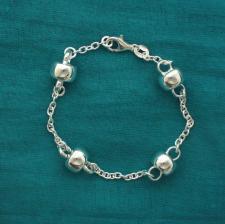 Braccialetto in argento con barilotti. Gioielli in argento 925.