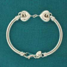 Sterling silver semi-bangle bracelet with double hearts.