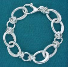 Bracciale artigianale argento 925 maglie ovali asimmetriche e maglie tonde godronate. Larghezza 1...
