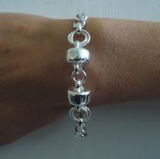 Sterling silver bracelet. ''Barilotto'' and diamond cut curb link chain.