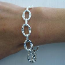Handcrafted sterling silver bracelet. Asymmetrical oval link 12mm.
