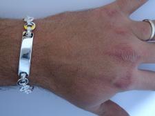 Bracciale argento 925 uomo con piastra e maglie tonde.