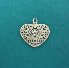 Ciondolo cuore traforato in argento.