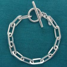 Bracciale in argento 925 massiccio, maglia allungata, filo sezione quadrata media. CHIUSURA A T-B...