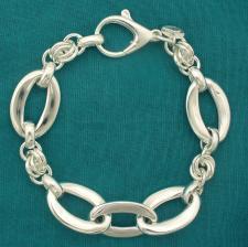 Bracciale artigianale argento 925 maglia forzatina ovale asimmetrica e maglie tonde. Larghezza 15...