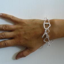 Sterling silver bracelet with heart link