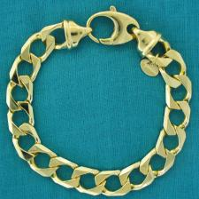 Sterling silver solid diamond cut curb bracelet 10mm. With 18 kt yellow gold plating.