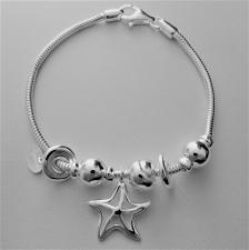 Bracciale in argento 925 charms scorrevoli. Fantasia stella marina, nodi e sfere.