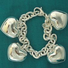 Sterling silver heart charms bracelet.